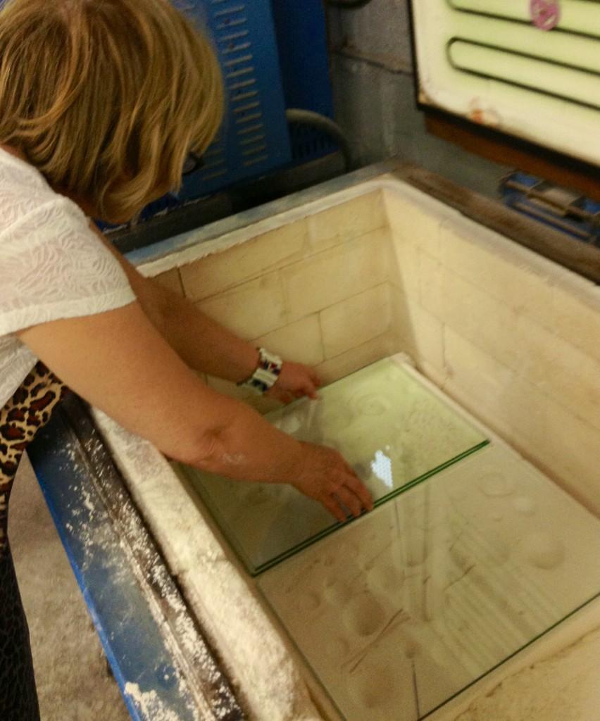 Mimi Gogusevski sets up the glass in the kiln.