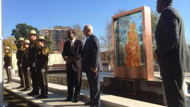 Montgomery County Executive Isiah Leggett (left) shakes hands with retired Navy Cmdr. Everrett Alvarez Jr. of Potomac, who was the longest-held prisoner of war in Vietnam, after Monday's dedication of Memorial Plaza and unveiling of the Eternal Memorial Flame in Rockville, MD