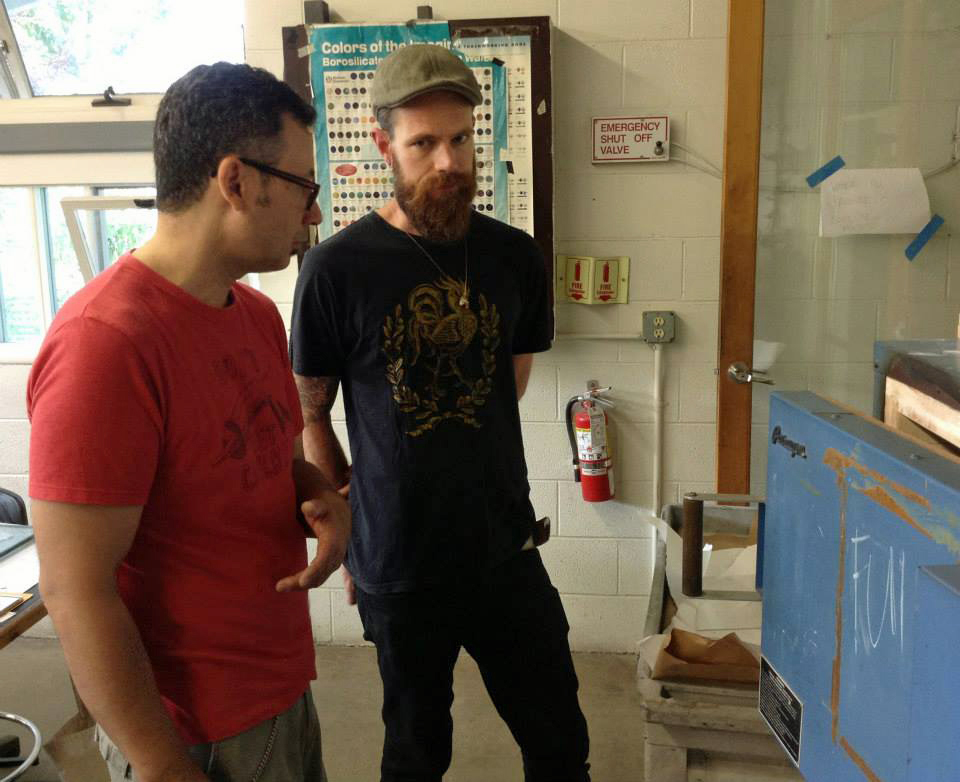 Michael Janis and Evan Morgan discuss kiln schedules at Penland School of Crafts.