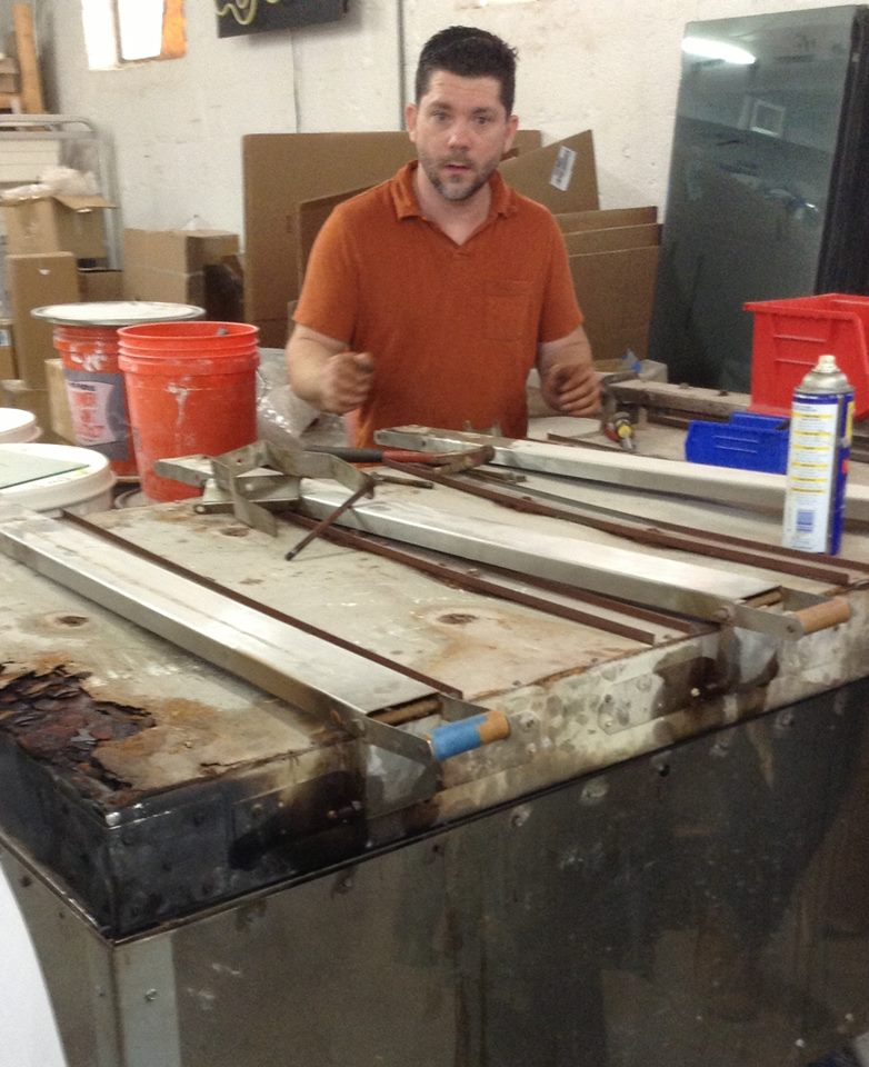 Head of the Glass Program at Salisbury University - Steven Durow - looking overwhelmed at rebuilding the casting kiln.