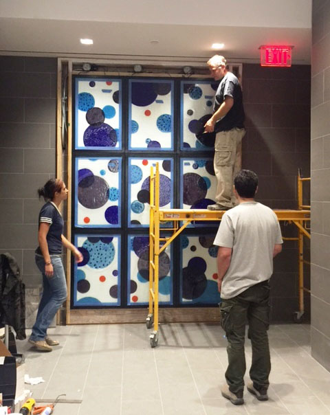 Installation of the main lobby artwork.