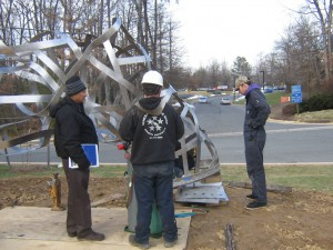 Matthew Duffy installing the public art sculpture in February. Photo by Janet Rems / Fairfax County Times