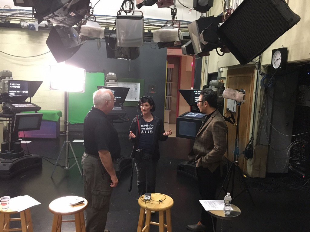 Jim Bigwood, audio engineer and Tracy Gaspari, MPT floor director, discuss glass and art with WGS' Michael Janis.
