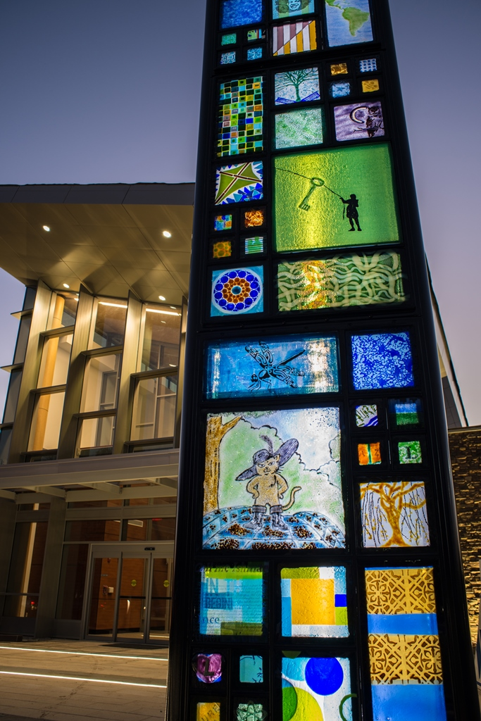 The artwork inset kiln-formed glass panels express the personality and the  individuality of everyone involved in the project.