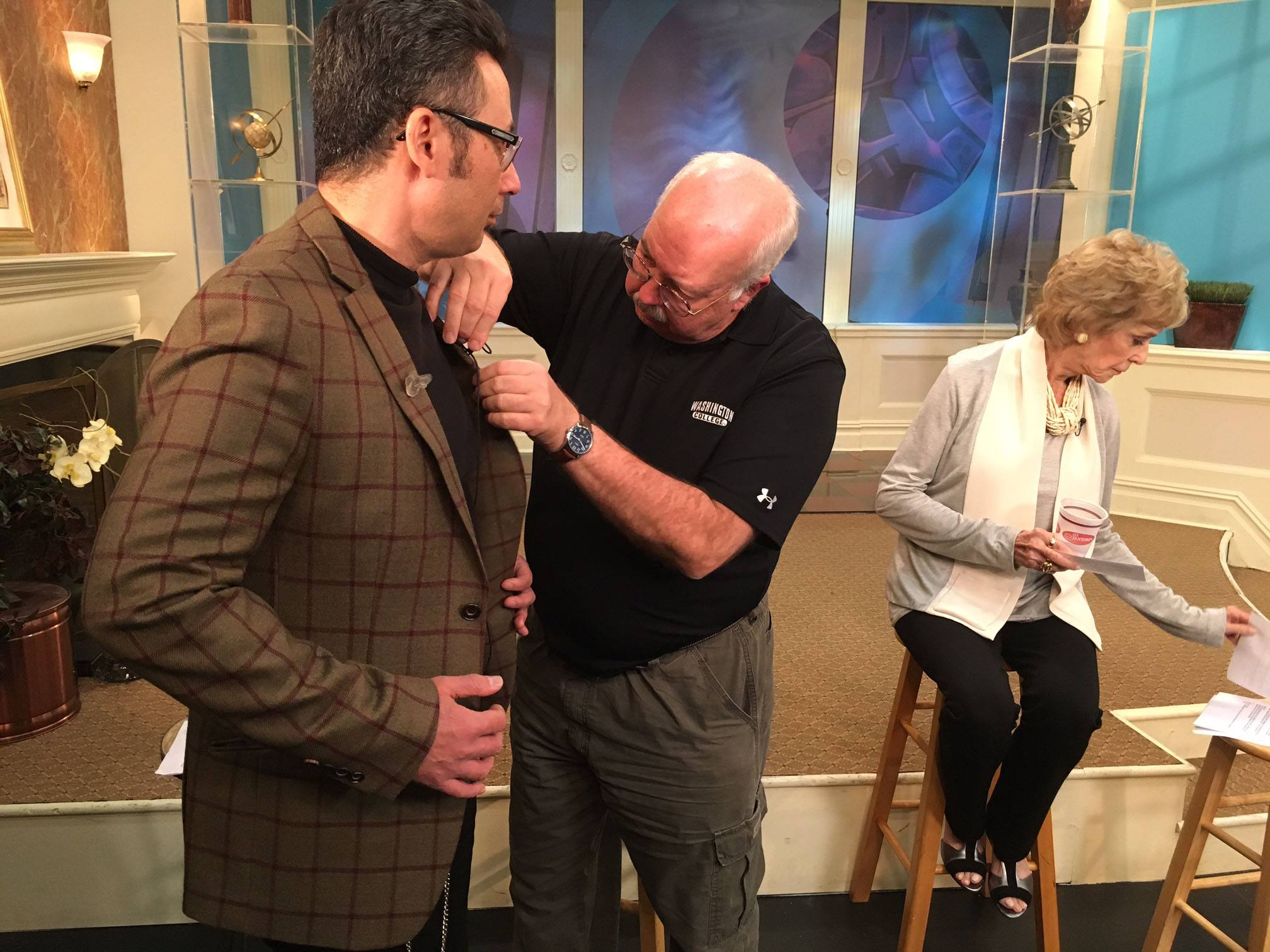 "WGS' Michael Janis gets mic'd up for a taping of Maryland Public Television (MPT)  ""Artworks"" taping."