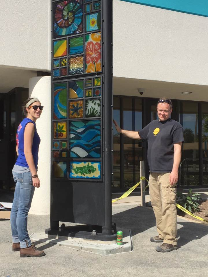 Audrey Wilson and Erwin Timmers install the public art in Palm Beach, FL.