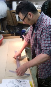 Artist Michael Janis begins creation of the colorful glass inset panels.