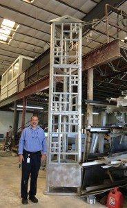Dave Dolan of Palm Beach County is part of the review process of the structural metal at the shop.