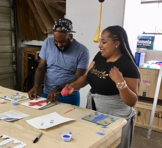 The KEYS Development instructors joing in the fun, making custom stencils.