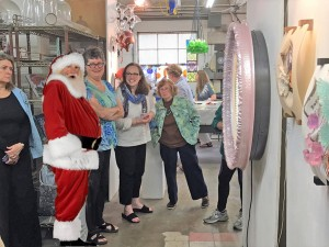 Santa plans the open house logistics on his last visit to the Glass School.