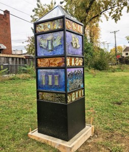 "View of sculpture ""Inspire"" located at 4215 Park Heights Ave, Baltimore, MD."