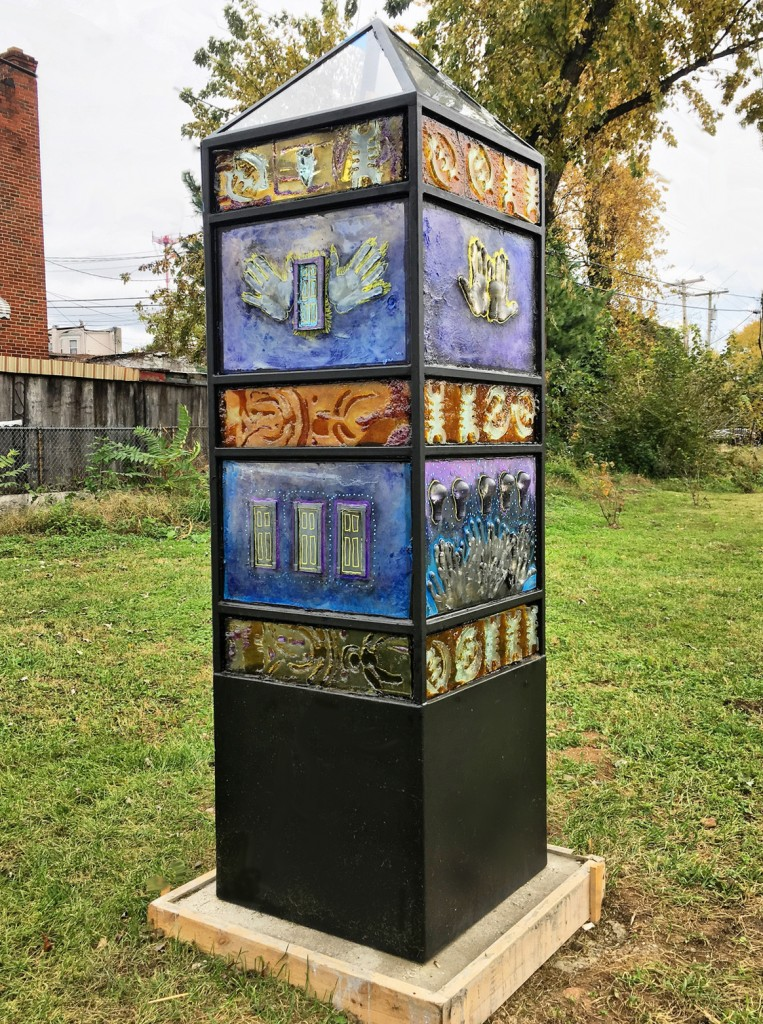 """Inspire"" ; cast glass and steel public art sculpture by Sean Hennessey and John Henderson for Baltimore's Lots Alive Outdoor Community Art Program."