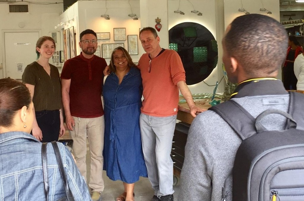Prince George's County Council Deni Taveras visits the glass studio and gathers artists for a photo opp.