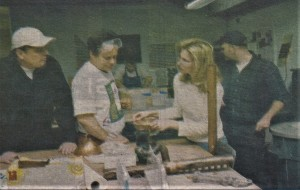 Tim Tate (L), Erwin Timmers (Center L) talk with a student about glass and steel sculpture. Circa 2001.