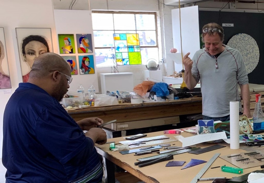 Erwin Timmers leads a community glass making workshop at the Washington Glass School.
