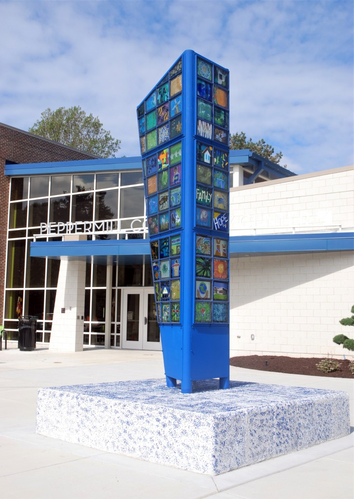 "The tower, titled :""Telling Our Story..."" adds a powerfull and dramitic artistic element at the new entry at the community center."