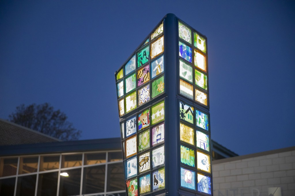Detail of the internally illuminated glass panels made with the Peppermill community as part of the public artwork.