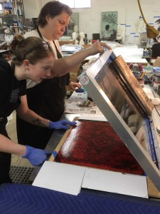 Teri Bailey and Patricia De Poel Wilberg work on silkscreening the enamel patterns on glass, to be fired in the kilns after.