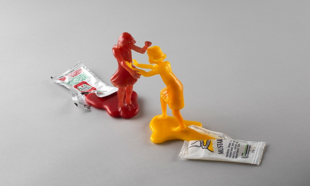 """Carmen Lozar, """"Fight"""", Flameworked glass and found object. 3""""H x 8""""L x 2""""D"""