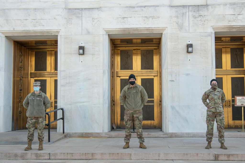 National Guard Soldiers stand guard at the John Adams Building, Library of Congress, Washington, D.C. National Guard Soldiers and Airmen have traveled to the National Capital Region to provide support leading up to the 59th Presidential Inauguration. (photo: Tech. Sgt. Lucretia Cunningham)